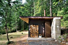 Photo by Tom Bies Tagged: Exterior, Cabin Building Type, Wood Siding Material, Metal Siding Material, and Concrete Siding Material. Photo 7 of 10 in 10 Tiny Cabin Homes That Will Have You Headed to the Forest from First-Class Cabins. Concrete Siding, Metal Siding, Tiny House Cabin, Cabin Homes, Tiny Homes, Dream Homes, Little Cabin, Little Houses, Wabi Sabi