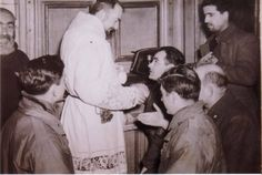 "theraccolta:  ""In the Sacristy: May, 1945  ""Padre Pio allows the kissing of his hands. Members of the 463rd Bomb-Group and Italians surround him.""  """