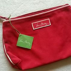 ☆☆NO OFFERS!☆☆ Vera Bradley NWT Pretty red (not as bright red as the pictures) makeup bag/traveling bag by Vera Bradley. No trades or paypal. Bundle for discounts. Vera Bradley Bags Cosmetic Bags & Cases