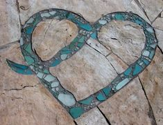 Sea glass mosaic in a stone walkway. Fireglass isnt just for Firepits! You can get creative and make your own Mosaic project. More Sea glass mosaic in a stone w Diy Garden, Garden Crafts, Dream Garden, Garden Projects, Mosaic Garden, Mosaic Walkway, Glass Garden, Sea Glass Mosaic, Pebble Mosaic
