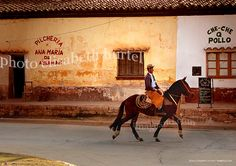 Gaucho riding through town, Argentina