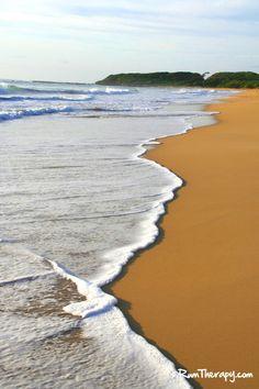 Golden sand beach in Kapaa, Kauai.
