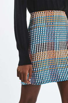 Add some colour to your wardrobe this season with this woven craft multi-colour mini skirt. In a high waisted fit, the skirt is cut flatteringly in an A-line shape. Wear with a basic funnel neck knit jumper for a contrasting feel. #Topshop