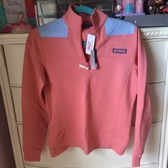 NWT! Vineyard Vines Rhubarb Shep Shirt Nantucket NWT! Vineyard Vines Rhubarb Shep Shirt Nantucket Red. This is a VERY coveted and RARE color!!! Price is a reflection of this. This item is brand new with tags. Perfect way to complete any preppy ensemble! Never worn. Perfect condition. Has been sitting in my dresser drawer forever. Time to go to a good home. Please ask any and all questions prior to purchasing. If you need more pics, just ask! 😊 Vineyard Vines Tops Sweatshirts & Hoodies