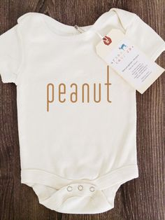 This unique outfit will suit your little peanut perfectly!  •Made out of 100% organic. Fair Trade cotton. •Please note, color(s) + image size may