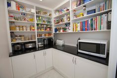 L-shaped pantry design with appliances bench.