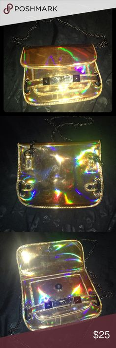 Holographic Clutch/Cross Body I only used this bag a couple times, it's too small for me, it's a good bag for a party/concert but not very practical. Awesome color, but the vinyl tends to get and deff has scratches. NOT UNIFF labeled so for exposure. UNIF Bags Clutches & Wristlets