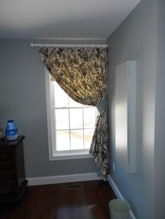 Classic Pinch Pleat Drapes with contrast lining and tieback hung from a decorative rod and rings