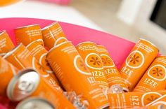 Izze soda for the non-drinkers? I dunno if they come in blue, but they definitely have orange.