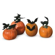 """Black Metal Pumpkin Decorations from Lillian Vernon. For $6.99, choose 2 crows, 2 bats, a witch or a cat (range 8""""-10 1/2"""" tall)"""