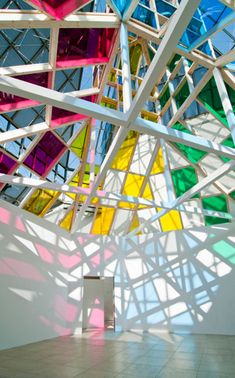 Daniel Buren, installation of colored glass sheets.