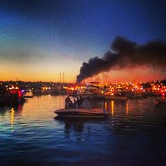 Fire breaks out just before the fireworks show in Seattle, WA, 4th of July Celebration.  Lake Union ... 14 boats were destroyed in a dry dock fire.