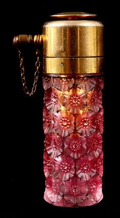 R. LALIQUE PINK STAINED SUSSFLED ATOMIZER with hexagonal flower head decora