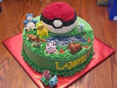 "Three chocolate 12"" layers on the bottom, covered in buttercream with gumpaste figures. The Pokeball was made using the Wilton sports pan. I used blue piping gel for the pond. My son was thrilled over his cake!"