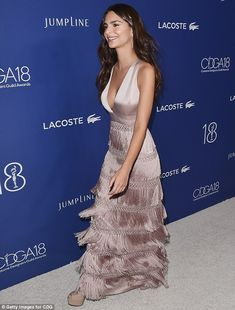 Check me out: Emily showed off the stunning frock's layers as she walked the star-studded red carpet