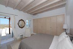Villa Ammonite is a 4 bedroom villa on Mykonos island, overlooking Psarrou beach. Diles Villas is a collection of luxury villas in Mykonos island. Mykonos Villas, Villa With Private Pool, Ensuite Bathrooms, Dining Chair Slipcovers, Bedding Sets Online, Dorm Bedding, Outdoor Living Areas, Cozy Bed, Home Bedroom