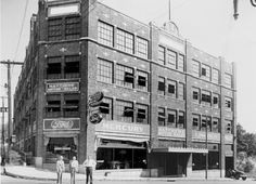 The Sawyer Motor Company Building used to be the location of Matthews Ford Lincoln Mercury. There are internal car ramps, so that the upper floors store the vehicle inventory and the main floor is the showroom. Note the Ford Tractor coming out the garage door on the right.