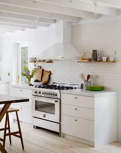 beautiful brass details in an all white kitchen   light and airy house tour on coco kelley