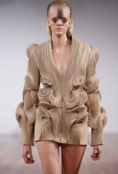 by Iris van Herpen really that face would sell a shirt? Nuts!!