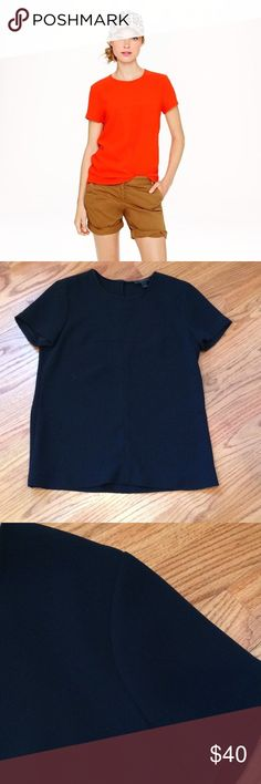 J.Crew black matte crepe top Never worn.  Bought and just sat in my closet. Nice heavy material.  T-shirt shape but more elegant.  Cute keyhole button latch in back. Can dress it up or down.  Make it yours! J. Crew Tops Blouses