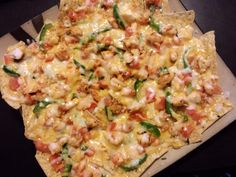This is Spicy Shrimp Nachos. This is a tasty treat that we whipped together one night after being inspired by the fish tacos we had made the night before. We had all the ingredients we needed left over from the tacos (minus the fish) and we had some shrimp so we thought, why not nachos. The result was spectacular.  RECIPE: http://goo.gl/ZnBdtM