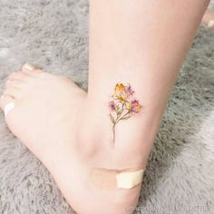 Possibly the best mini watercolor floral tattoo we've seen. By Handitrip