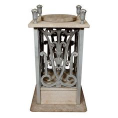 Art Deco Pedestal w/ Floral Detailing by Edgar Brandt | From a unique collection of antique and modern pedestals at https://www.1stdibs.com/furniture/tables/pedestals/