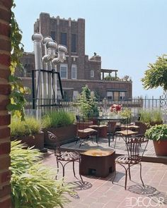 The terrace, which was designed by Daniel Romualdez, features pots of fountain grass and August lilies.