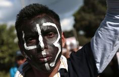 Tecoanapa, Mexico A student with his face painted takes part in a protest march. People protested over the disappearance of 43 college students, of which Alexander Mora was recently identified following the finding of remains in a landfill in Cocula.