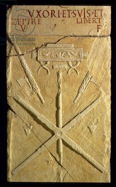 Funeral stele showing the attributes of a surveyor, from the stela of Eburia, Fausto, Roman (stone). Museo della Civilta Romana, Rome, Italy