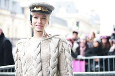 Lena Perminova in a militray hat.
