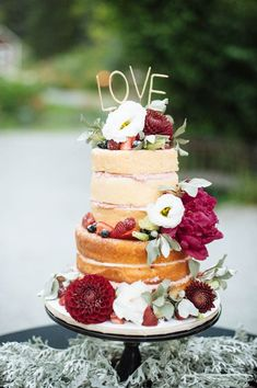 Jewel toned three tier fresh florals wedding cake |  image by Erica Rose Photography