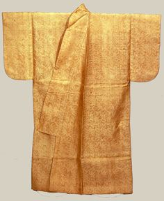 This kosode (kimono) is one of the worlds oldest extant kimonos.  Design of paulownia and bamboo in light brown twill weave ground.  16th century, Japan.  Designated Important Cultural Property. Tokyo National Museum