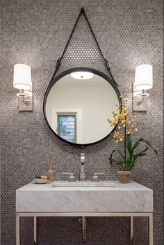 This is a clean, modern and sleek bathroom. Grey has become one of the hottest trends and in this space it shows why. The use of the grey penny-round mosaic wall tile gives this space a touch of excitement and interest.