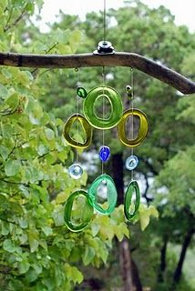 Recycled glass and driftwood wind chimes by Kathy Rossi.  I think this would look good on my back porch!