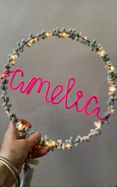 Perfect for twinkling away any night-time fears, these personalised kids bedroom fairy lights spell out the name you choose in a pompom hoop. The fairy light hoop is a combination of 20 lights, wrapped with pompoms and fine metallic threads and a name of up to 9 characters wrapped in wire. The hoop is powered by a mini battery pack or there's the option to choose a USB plug instead. Hang from a wall hook or make a beautiful 'shelfie' for a child's space they can really call their own. Modern Kids Bedroom, Shelfie, Metallic Thread, Fairy Lights, Wall Hooks, Twinkle Twinkle, Kids Rooms, Night Time, Hoop