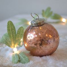 Set Of Three Copper Christmas Tree Baubles. For an industrial style tree. From notonthehighstreet.com.