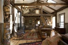 Gatlinburg cabin rental - The Greatroom has two seating areas. With a vintage totem pole, fire place, TV