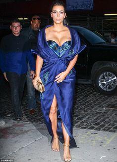 Taking the plunge: Kim Kardashian flashed the flesh in New York City as she left her hotel... photo: Wagner Az