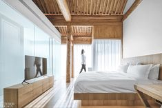 Archstudio transforms an early Beijing building into Layering Courtyard, a one-of-a-kind boutique hotel and hospitality venue.