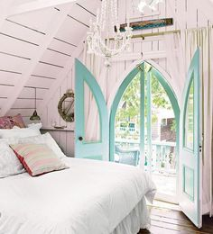 Beautiful bedroom door...reminds me of some of the doors we saw this summer on Martha's Vineyard cottages-sweet!
