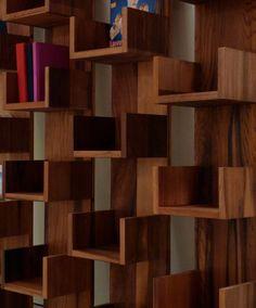http://www.booktryst.com/2010/05/leaning-bookshelves-of-deger-gengiz.html