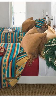 Pendleton blankets and suede pillows. These  would be fairly easy to make with castoff leather jackets from the thrift store.