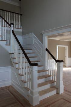 newel post, light oak floors w/dark railing