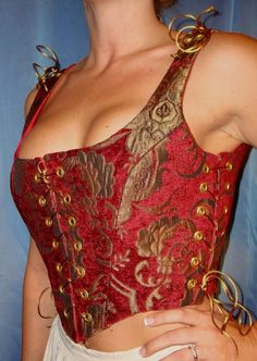 Love the corset, though it would end up an empire waist on me.  I could do without the curlicues...