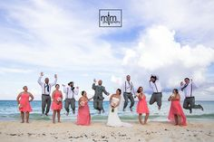 Wedding party beach jump! Wedding newlyweds. Iberostar Tucan Wedding Photographer. Playa del Carmen All Inclusive Beach Wedding Resort. Unique Wedding Photography. Top Wedding Photographer rated number 1 by Destination Wedding. MTM Photography