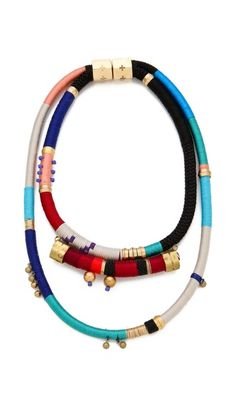 Holst + Lee  Yigal Necklace, 345.00 usd.  Bright thread wraps this double Holst + Lee necklace in a brilliant spectrum of color. Delicate beads dangle from the multi-hued sections, a stark contrast to the statement-making magnetic clasp.    Made in the USA.    MEASUREMENTS  Length: 20in / 51cm  Drop: 9in / 23cm