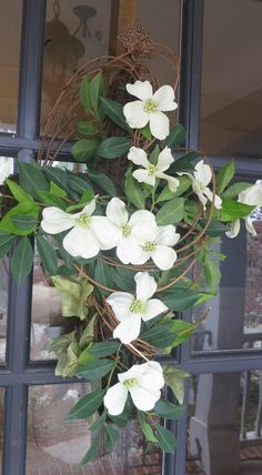 Grapevine, moss and dogwood Easter cross for the front door.  mursondesigns.com