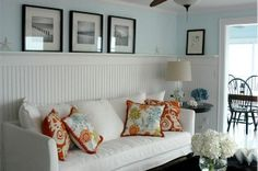 Love the color on the walls and the accent pillows... and the black and white beach photos. So, pretty much everything.