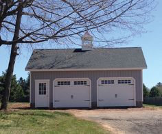 24' x 28' Vintage Cape Garage: T-1-11 siding, Carriage style overhead doors with Stockton glass, Door upgrade and Cupola.